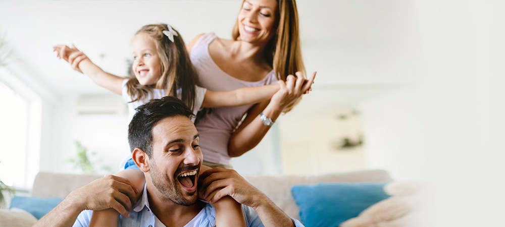 Family playing together in living room comfortably because of heating repair service by Chaffee Air